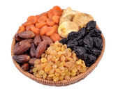 Various dried fruits in wicker bowl — Stock Photo