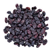 Heap of dark raisins on a white — Stock Photo