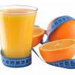 Oranges, glass of orange juice and measuring tape — Stock Photo #37548487