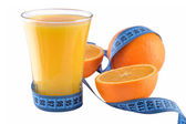 Oranges, glass of orange juice and measuring tape — Stock Photo