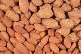 Heap of almonds close up — Stock Photo