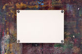 Sheet of watercolor paper pinned to wooden easel — Stock Photo