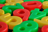 Colorful plastic numbers — Stock Photo