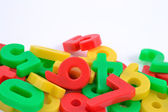 Colorful plastic numbers on white — Stock Photo