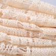 Stack of white openwork knitted fabric — Stock Photo #43352417