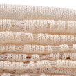 Stack of white openwork knitted fabric — Stock Photo #43352445