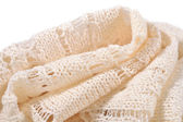 Stack of white openwork knitted fabric — Stockfoto