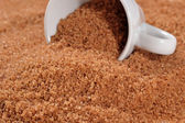 Brown sugar in a cup — Stock Photo