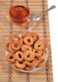 Bagels and a tea cup — Stock Photo