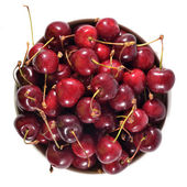 Top view of red cherries in a white bowl on a white — Stock Photo