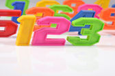 Colorful plastic numbers 123 on white — Stock Photo