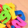 Heap of plastic colored numbers — Stock Photo #51216987