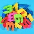 Heap of plastic colored numbers on a blue background — Stock Photo #51216991