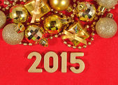 2015 year golden figures on a red  — Foto Stock