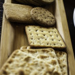 Various biscuits on a wooden plate — Foto Stock