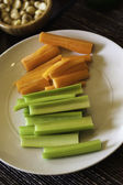 Sliced fresh celery and carrots — Stock Photo