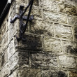 Stock Photo: Metal angle bracket on old stone wall