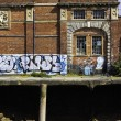 Stock Photo: Graffiti on old building