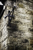 Metal angle bracket on old stone wall — Stock Photo