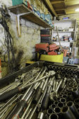Garage interior with variety of tools — Stock Photo