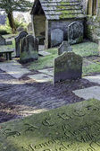 Rustic Churchyard and gravestones — Stock Photo
