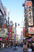 OSAKA - MARCH 10: The famed advertisements of Dotonbori on March 10, 2014 in Osaka, Japan. With a history reaching back to 1612, the districtis now one of Osaka's primary tourist destinations. — Stock Photo