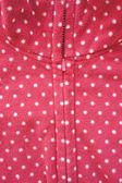 Closeup of zipper opening red fleece jacket — Stock Photo