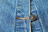 Metal button on jeans close up — Stock fotografie