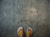 A pair of feet floor with word start for the concept of starting point — Stock Photo
