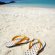 Yellow beach slippers — Stock Photo