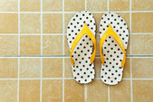 Yellow sandals on floor — Stock Photo