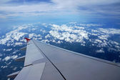 Airplane wing in the sky — Stock Photo