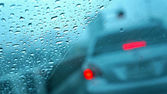 Rain drops on car glass, focus on raindrops — Stock Photo