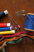 Sewing items with a vintage feel, thread, antique scissors, pins and buttons — Stock Photo