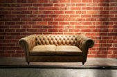 Leather sofa in brick wall room — Stock Photo