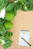 Fresh organic vegetables on a Wooden Background and paper for notes — Stock Photo
