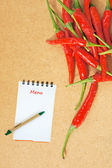 Red chili on a Wooden Background and paper for notes — Stock Photo