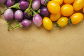 Tomatoes on a wooden background — Stock Photo