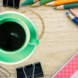 Green coffee cup and office supplies. View from above. Closeup — Stock Photo