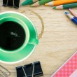 Green coffee cup and office supplies. View from above. Closeup — Stock Photo #46271899