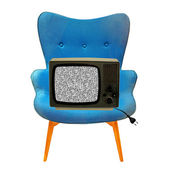 Vintage tv on a blue chair — Stockfoto