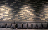 Sofa in brick room and lighting on wall — Стоковое фото