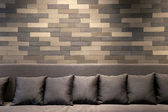 Sofa in brick room and lighting on wall — Foto Stock