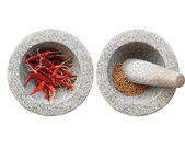 Stone mortar and pestle, with chili and peppercorn inside — Stock Photo