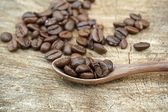 Coffee beans on an old wooden background — Foto Stock