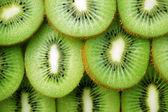 Krásný kiwi ovocné řezy pozadí — Stock fotografie