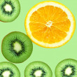 Fruity background set of slices of orange fruit and kiwi — Stock Photo