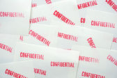 Many stamped confidential on white paper — Stock Photo