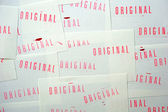 Many stamped original on white papers — Stock Photo
