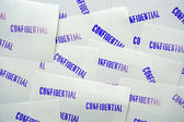 Blue stamped confidential on white memo papers — Stock Photo